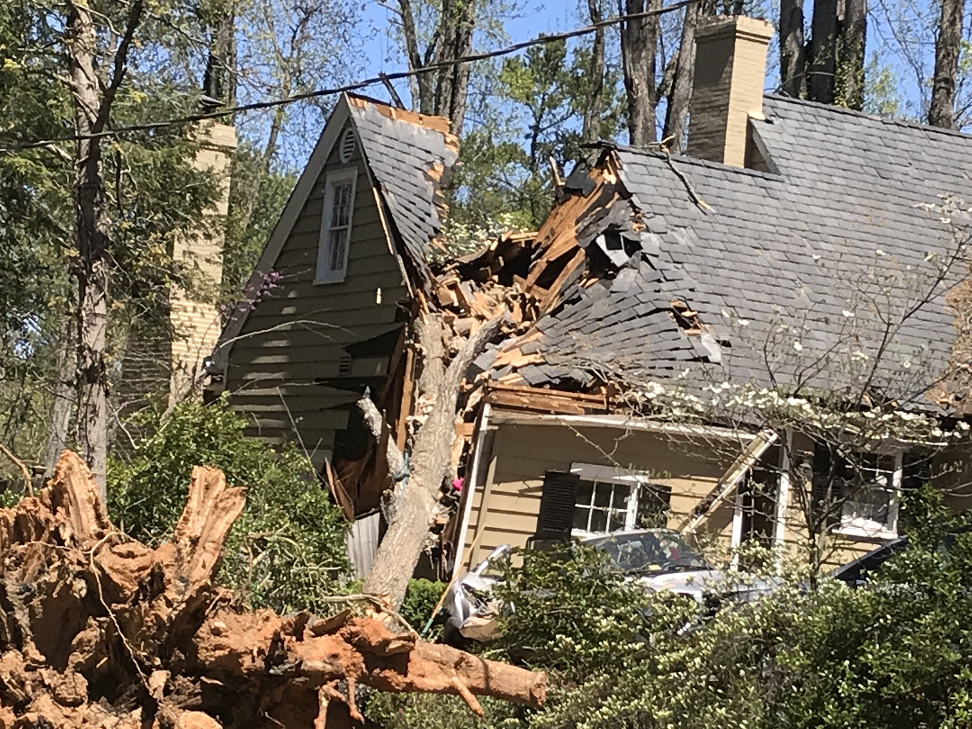 Tree on a house due to Hurricane and tornado storm damage